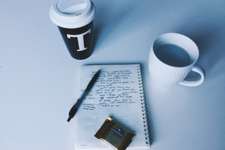 writing supplies and coffee