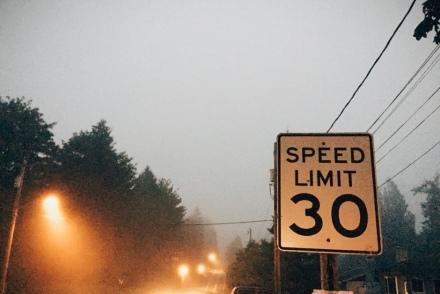 speed limit sign in the fog